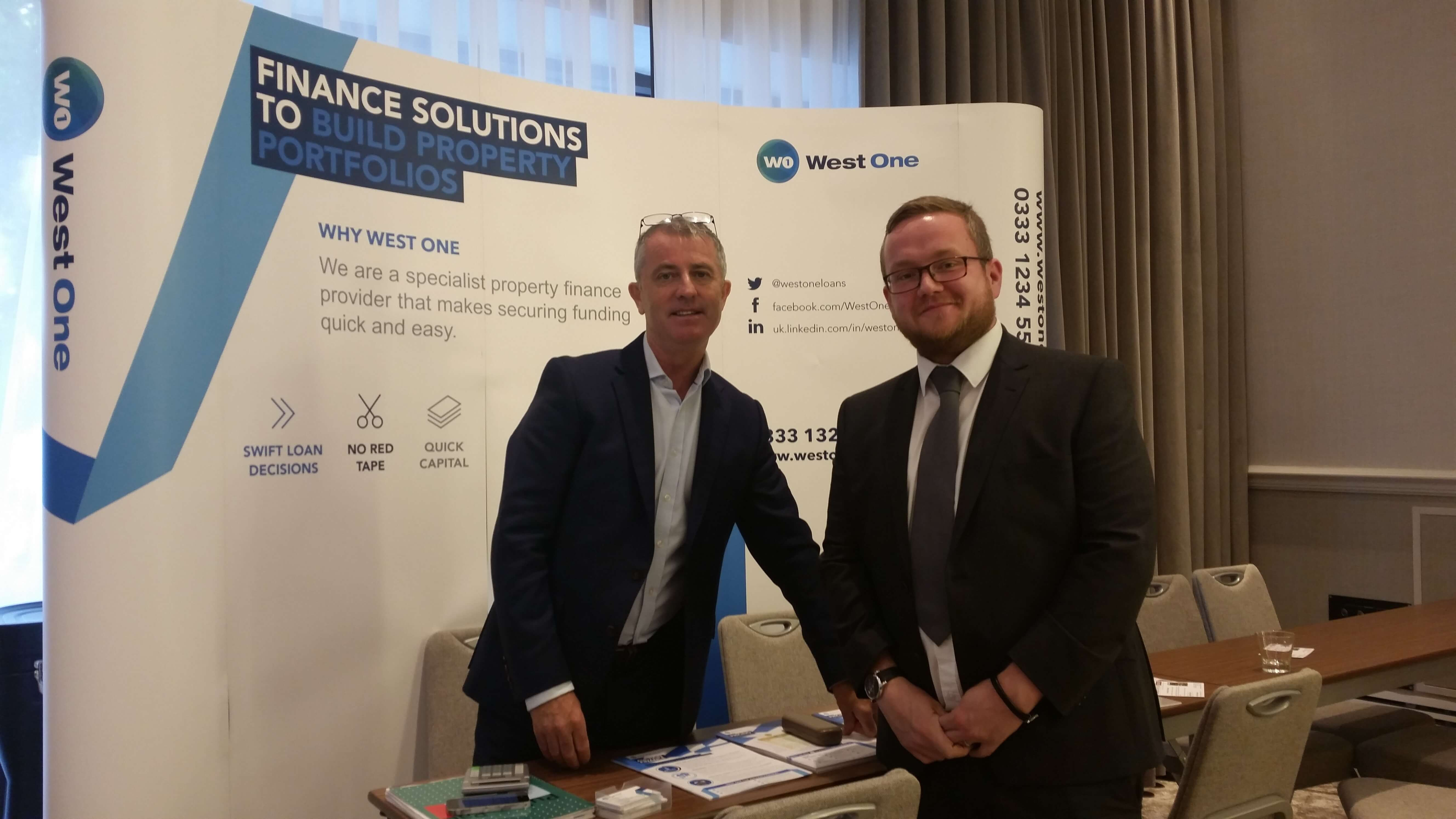 west one loans team at property auction house with bridging loans